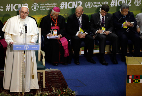 Pope Francis delivers his speech during the United Nations Food and Agriculture Organization (FAO) second International Conference on Nutrition, in Rome, Thursday, Nov. 20, 2014. The conference, jointly organized by FAO and the World Health Organization (WHO), takes place at FAO headquarters in Rome from Nov. 19 to 21. (AP Photo/Gregorio Borgia, Pool)